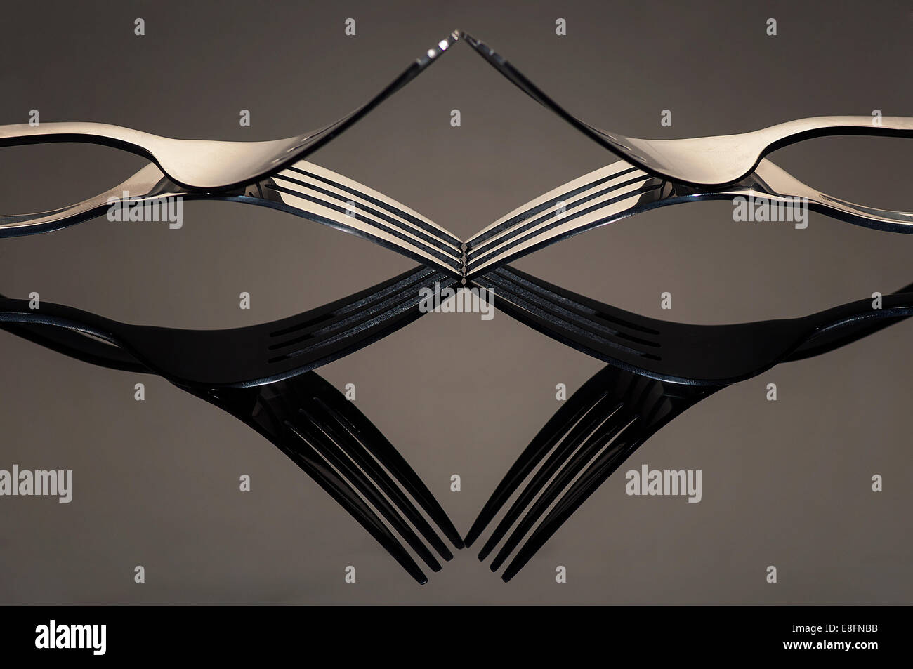 Indonesia, Jombang, Unique reflections of pair of forks - Stock Image