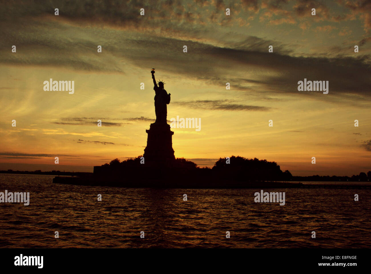 USA, New York State, New York City, Statue of Liberty at sunset Stock Photo