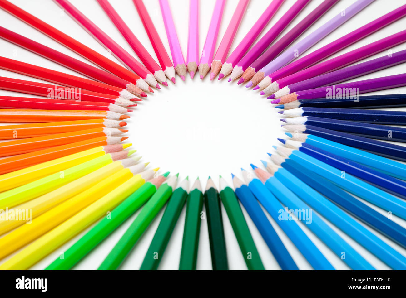 Multi-colored Pencils arranged to form a circle - Stock Image