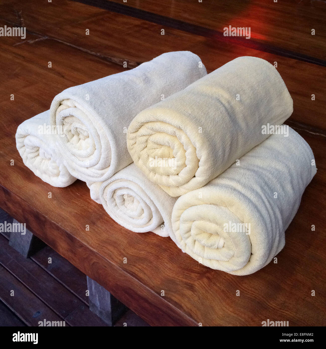 Rolled towels on table - Stock Image