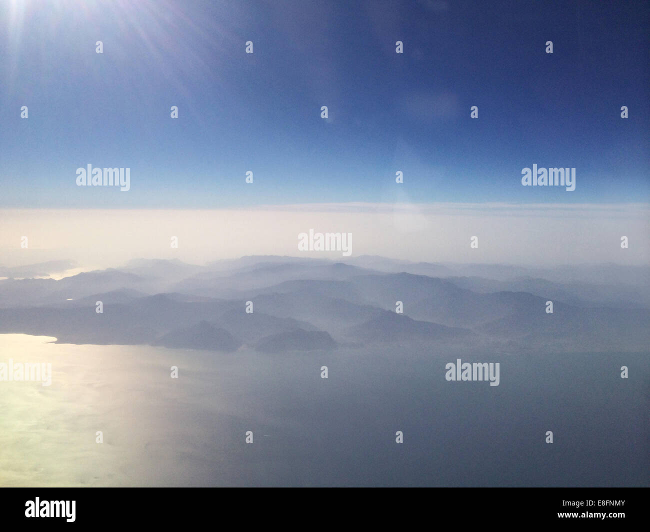 Aerial view of mountain range in early morning light - Stock Image