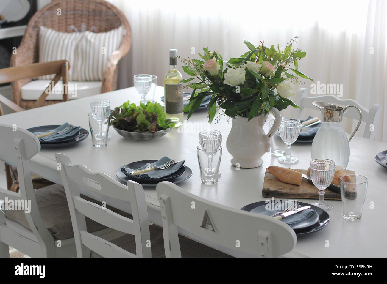 Dining table set for lunch - Stock Image