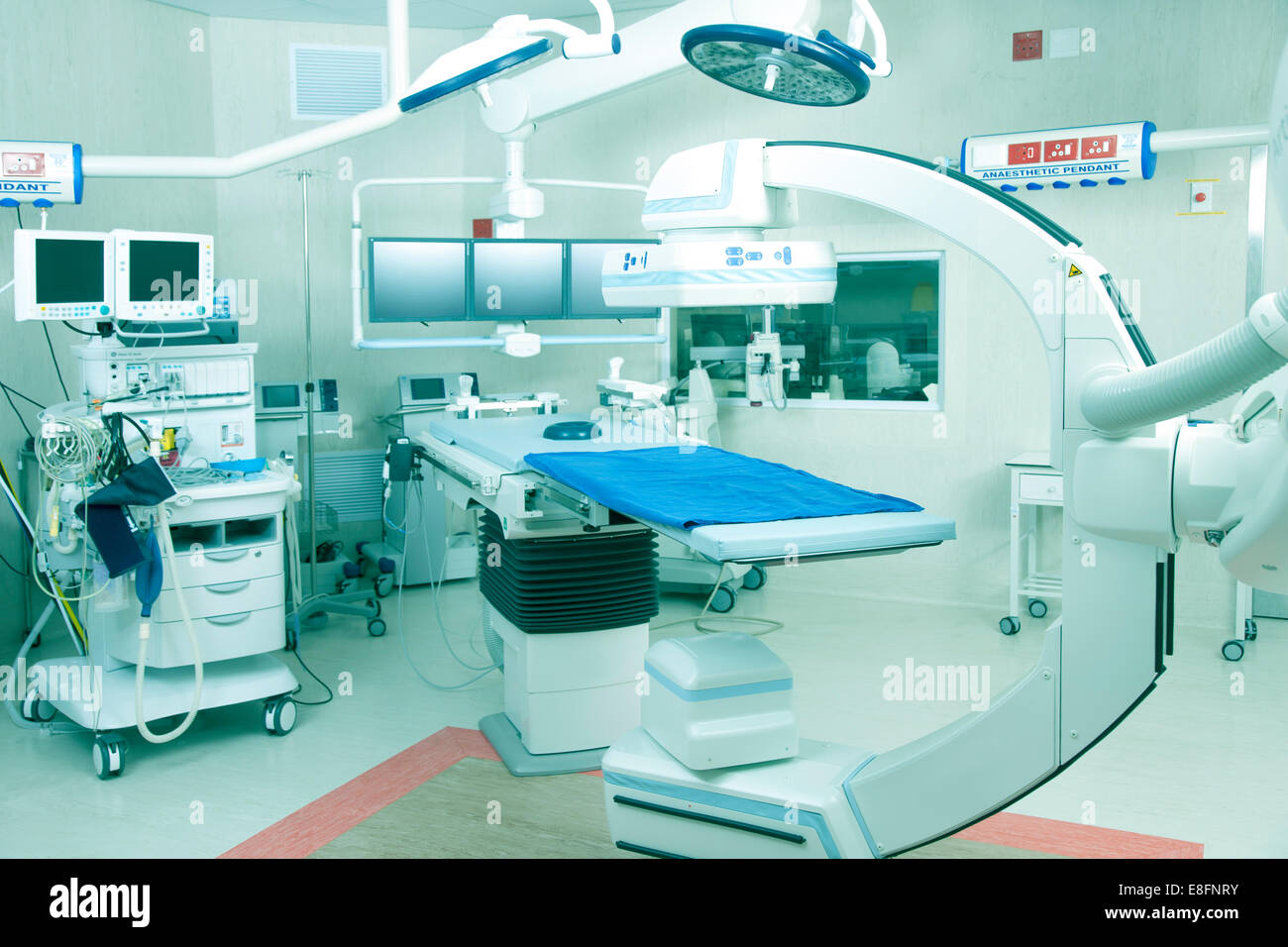 Operating room in hospital with robotic imaging system - Stock Image