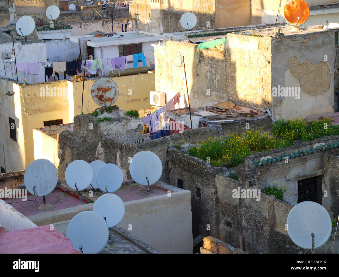 Satellite dishes on city rooftops, Morocco - Stock Image