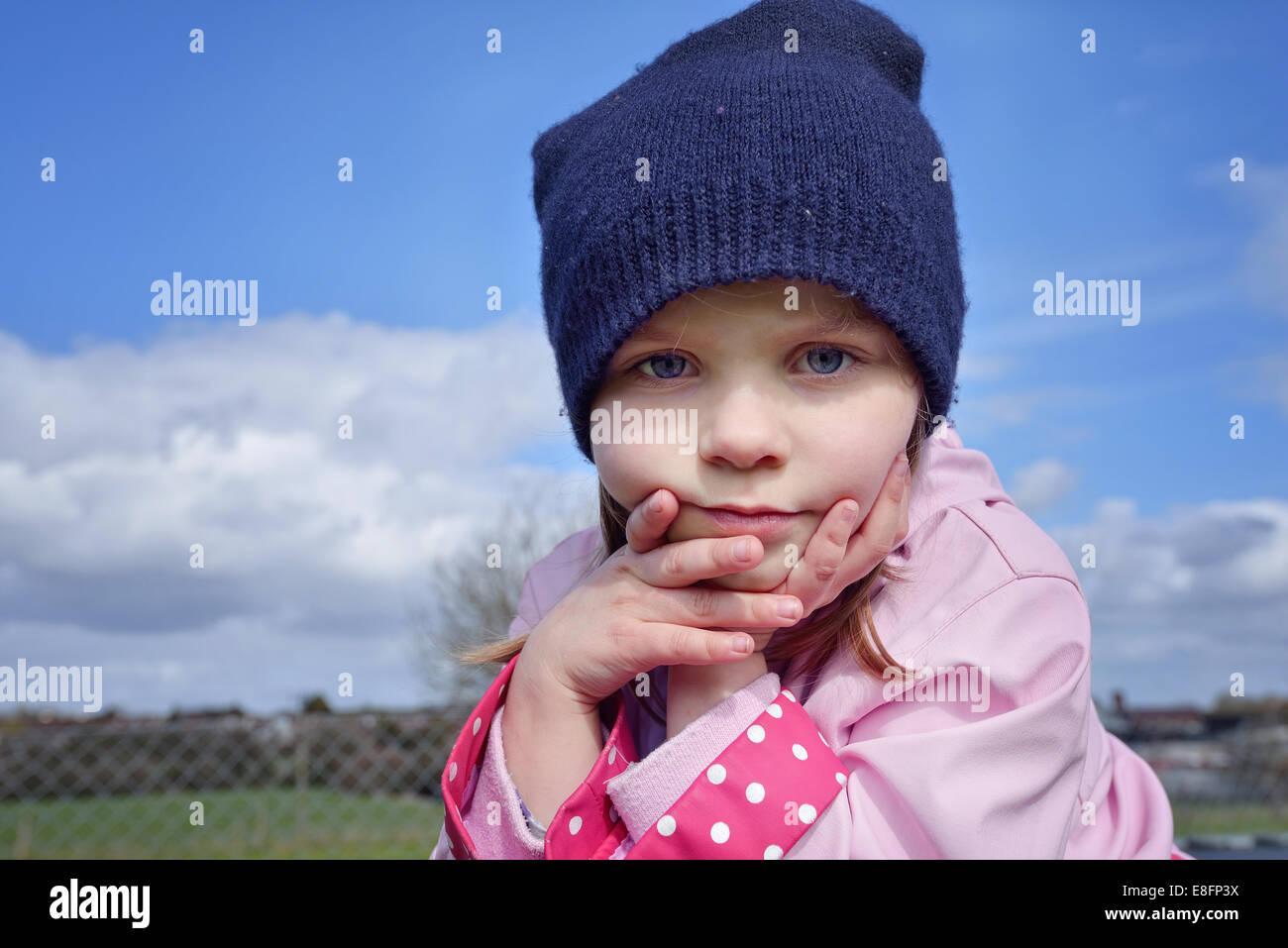 Portrait of pre school girl (2-3) outdoors - Stock Image