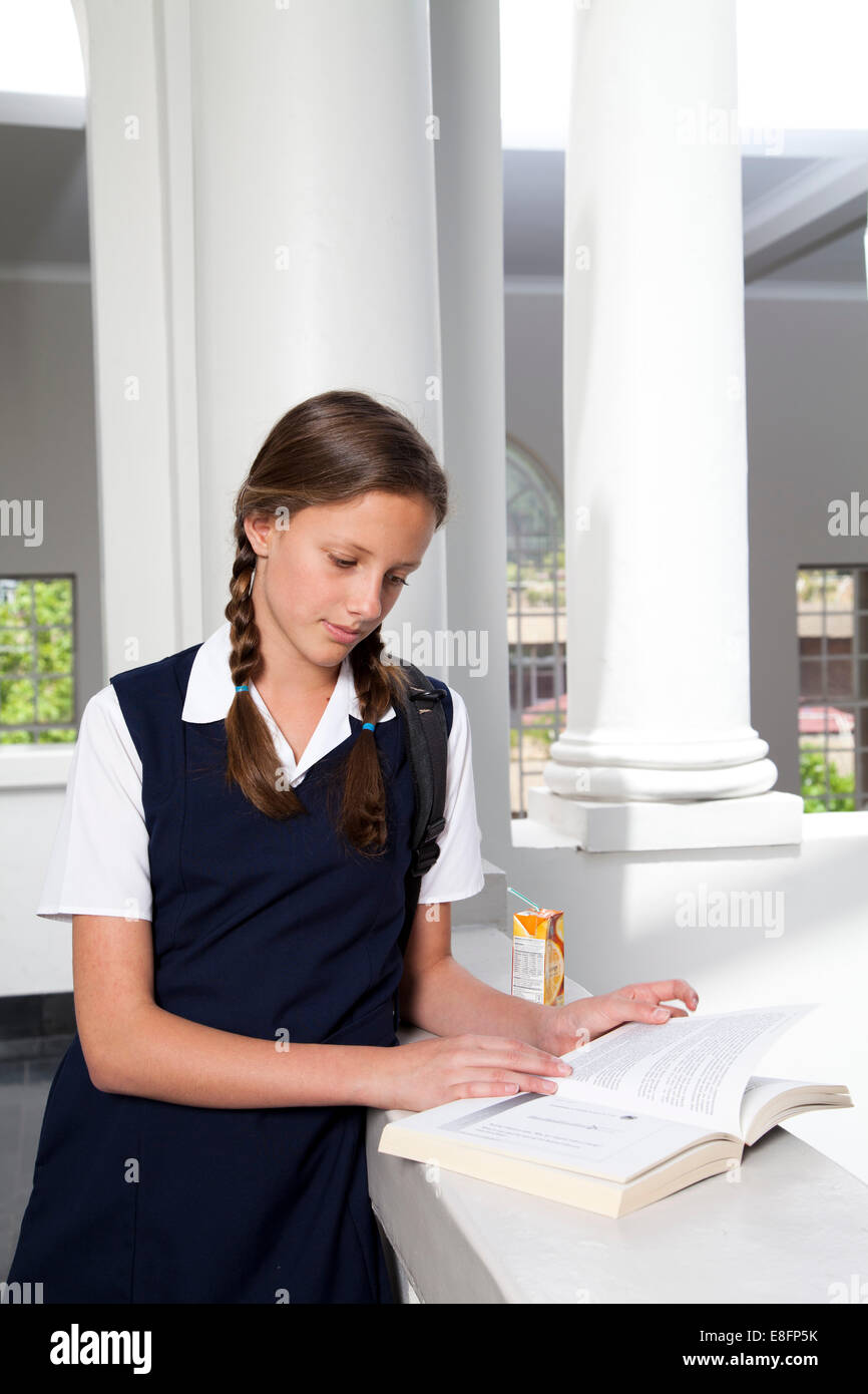 Portrait of a teenage student studying - Stock Image