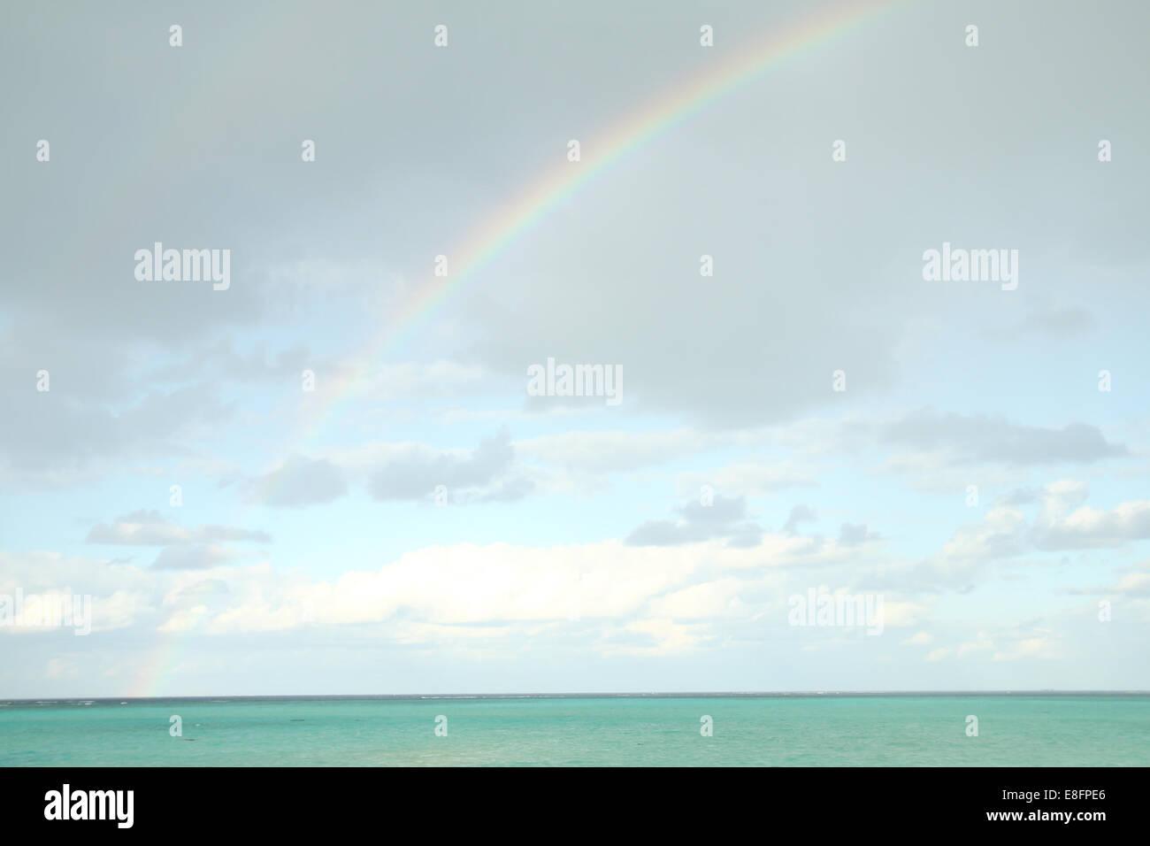 Rainbow over ocean, Japan - Stock Image