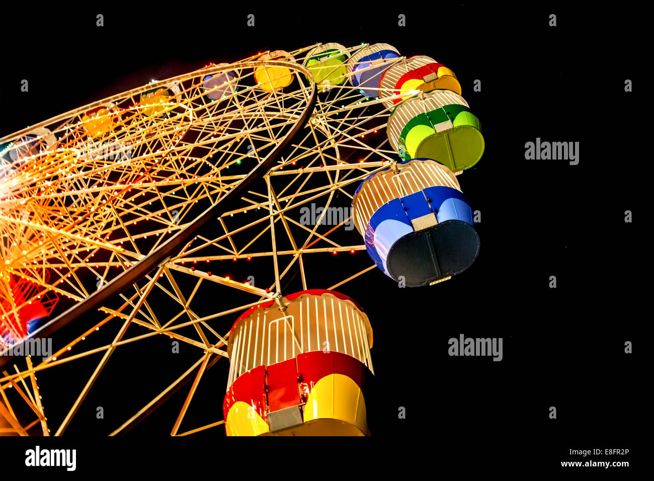 Australia, Sydney, Low angle view of Ferris Wheel At Night in Luna Park - Stock Image