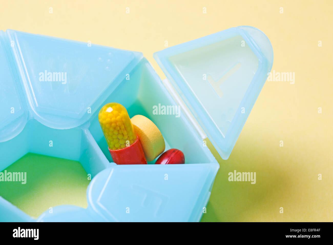 Pills in pill box - Stock Image