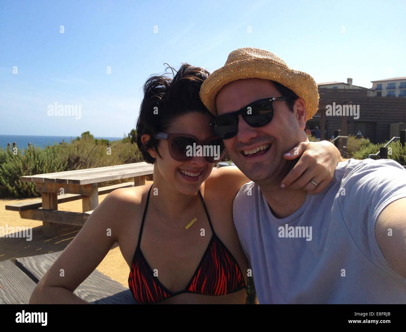 Couple taking selfie on holidays - Stock Image