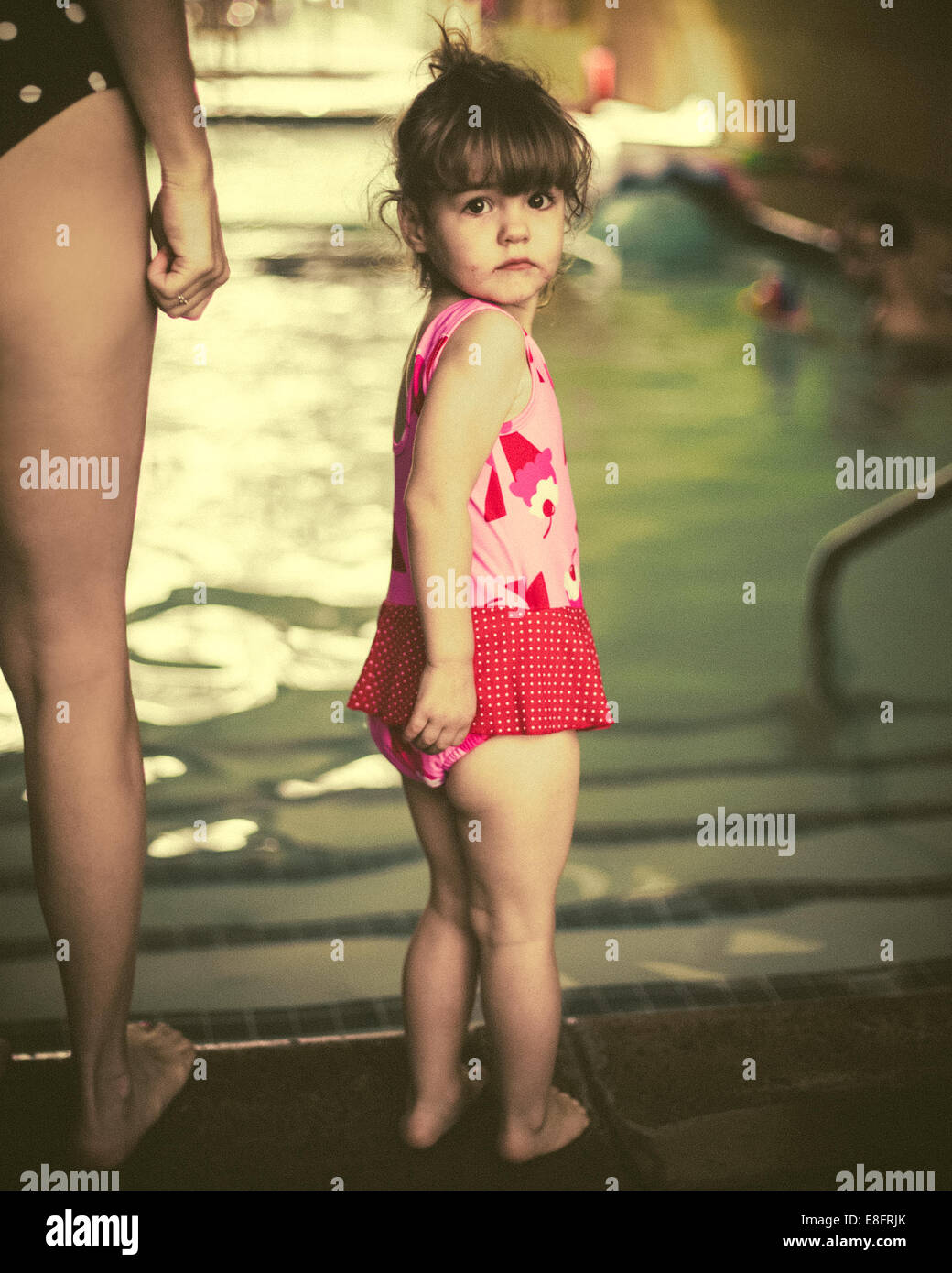 Girl (18-23 months) at swimming baths with her mother - Stock Image