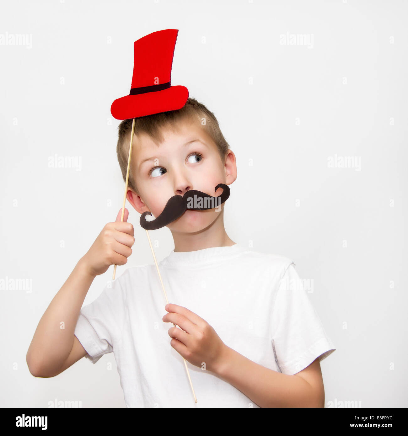 Boy with moustache and hat masks - Stock Image