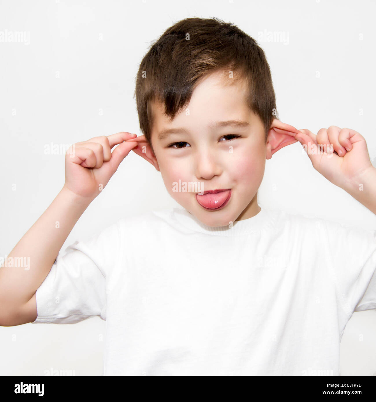Boy pulling funny face - Stock Image