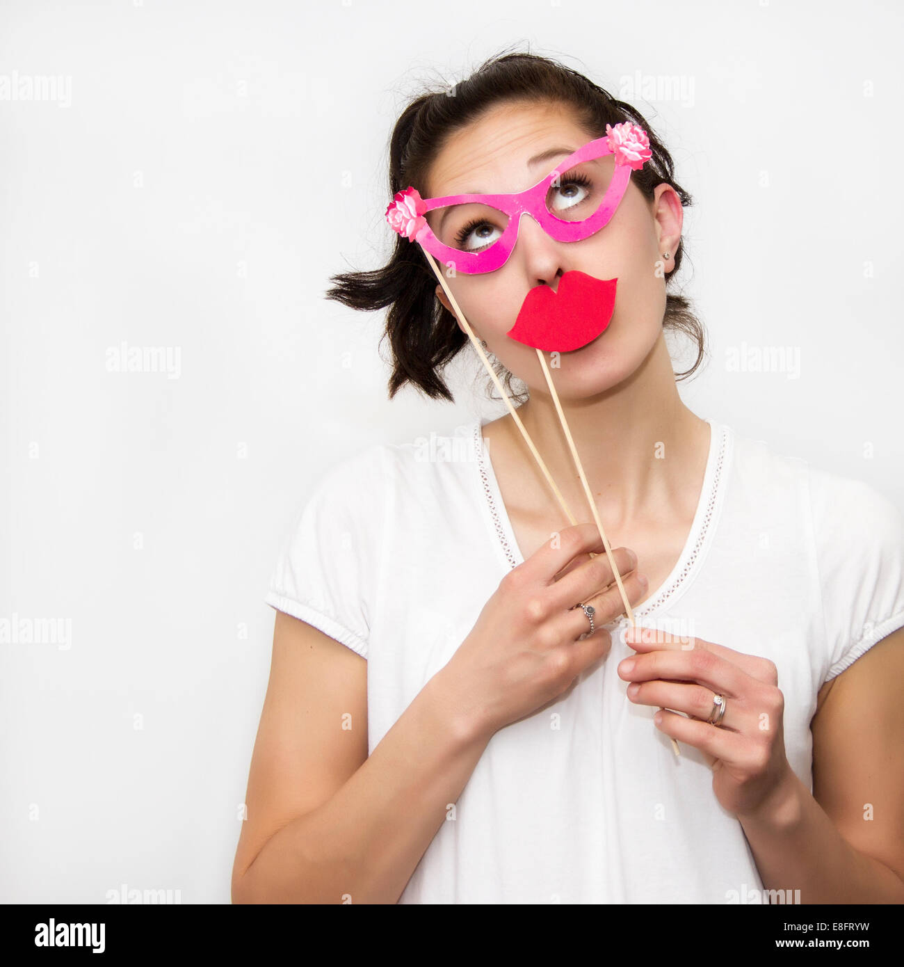 Woman holding lips and glasses masks - Stock Image
