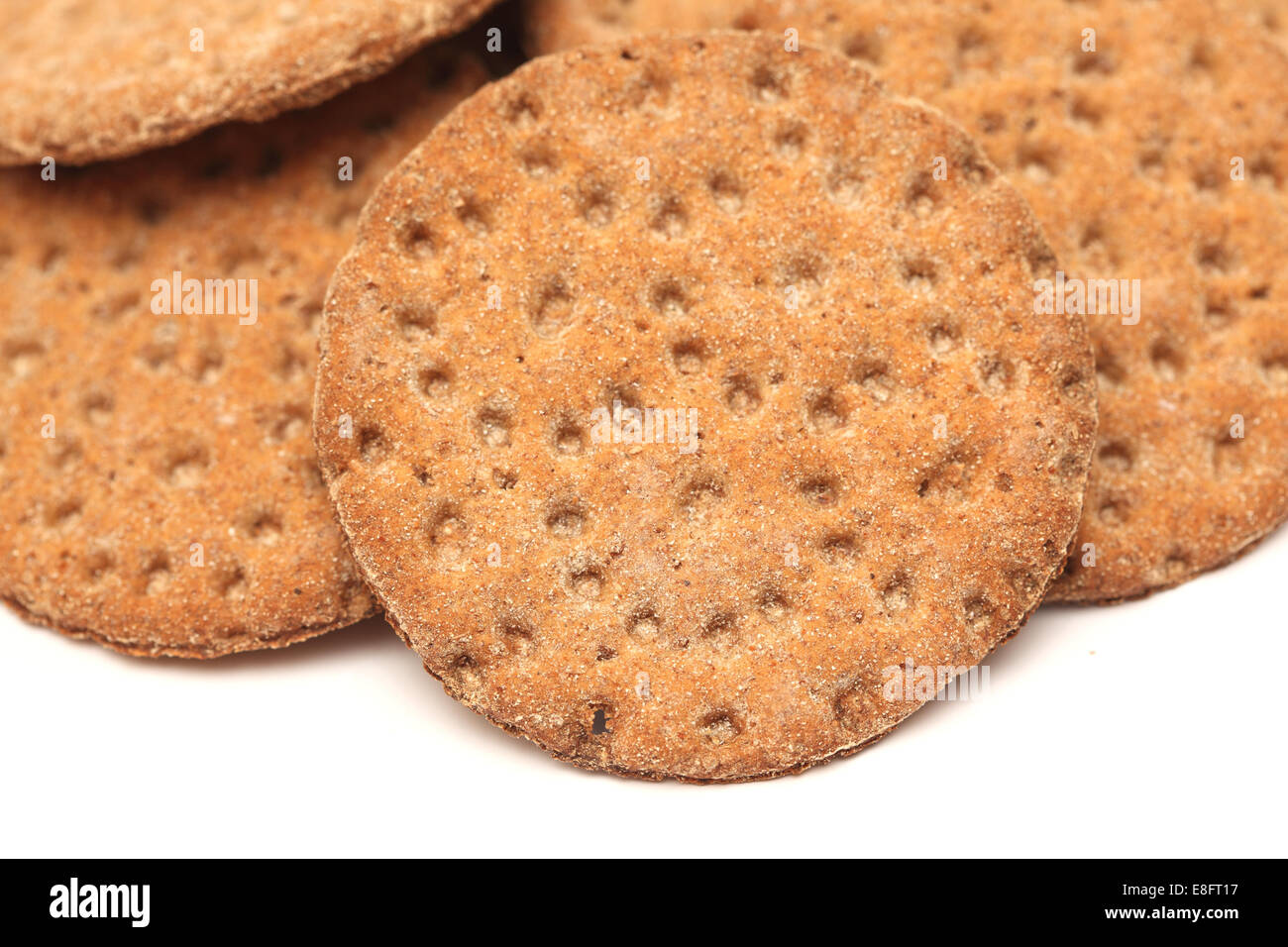 Round crispbread on a white background - Stock Image