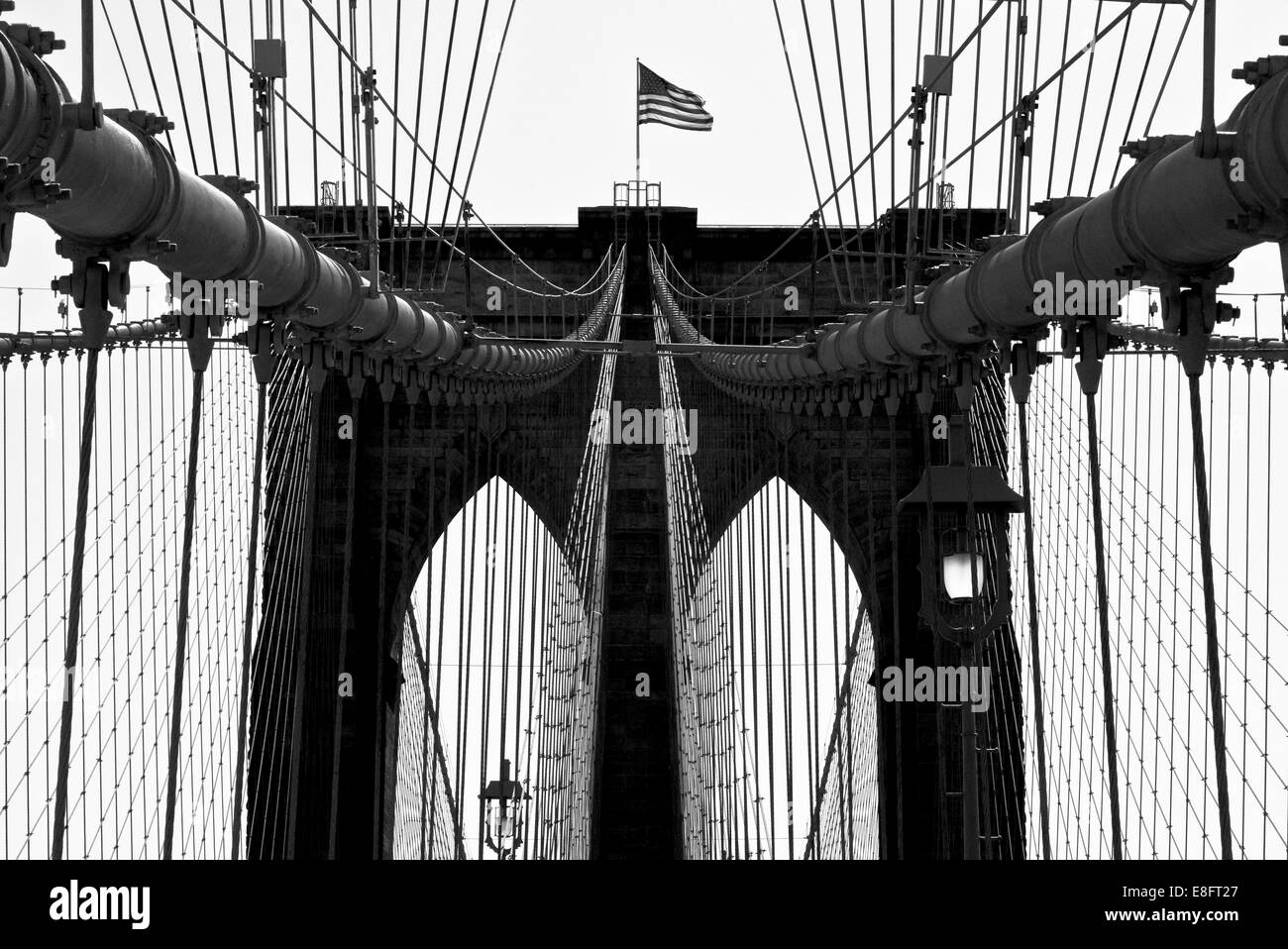 USA, New York City, Manhattan, Close up of Brooklyn Bridge with flag - Stock Image