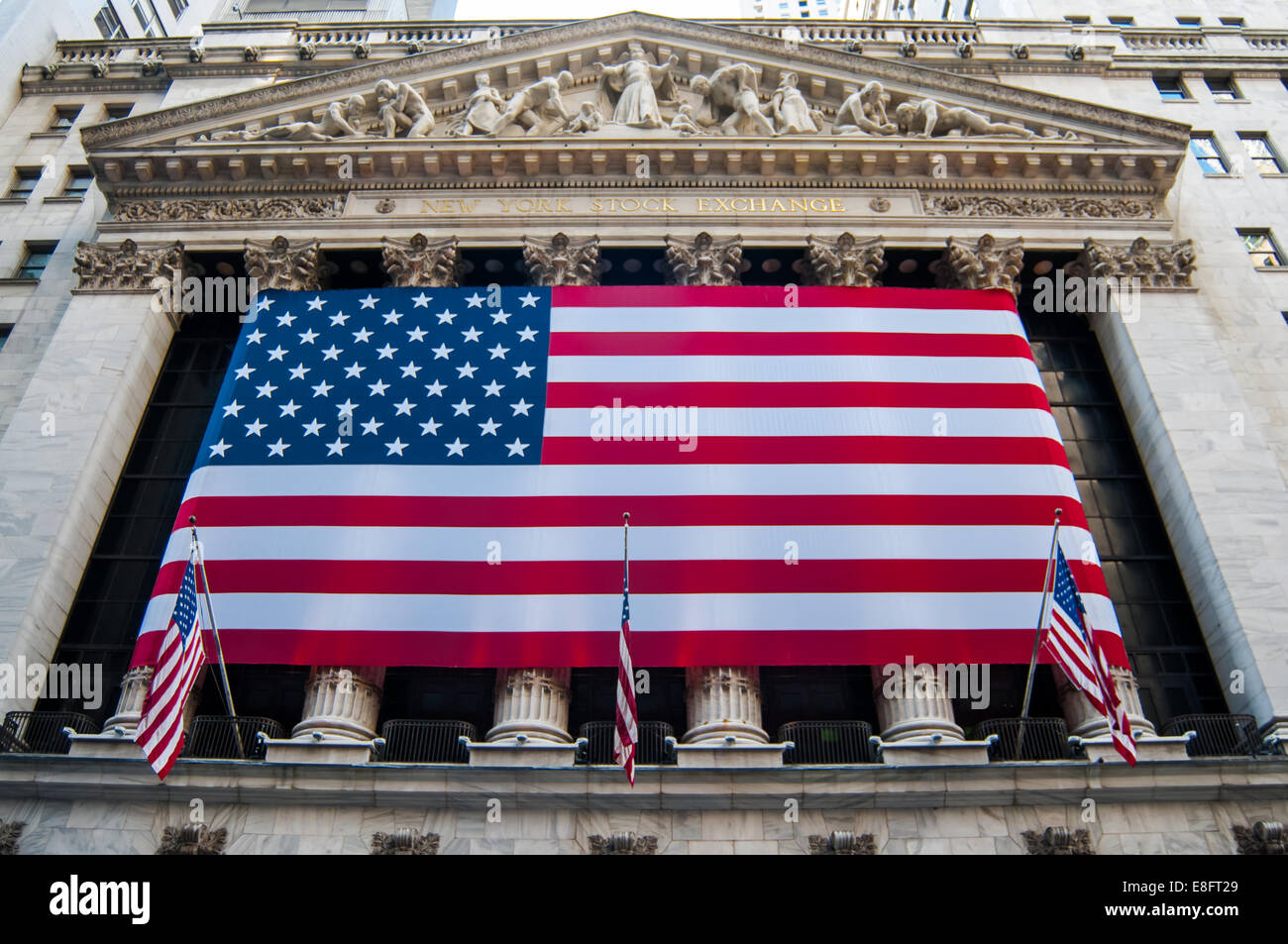 USA, New York City, Close up of New York Stock Exchange's facade with american flag Stock Photo