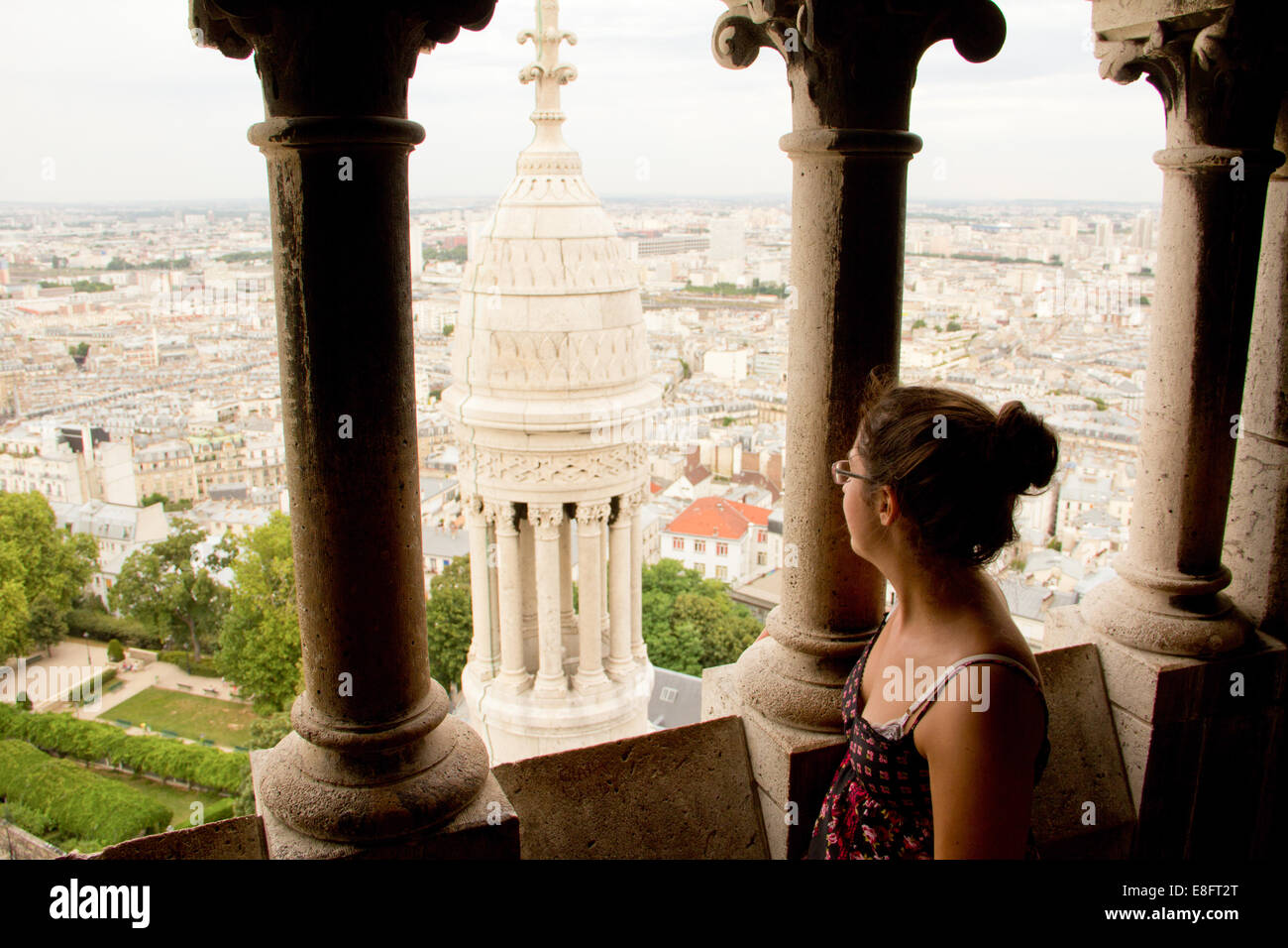 Woman looking out over city - Stock Image