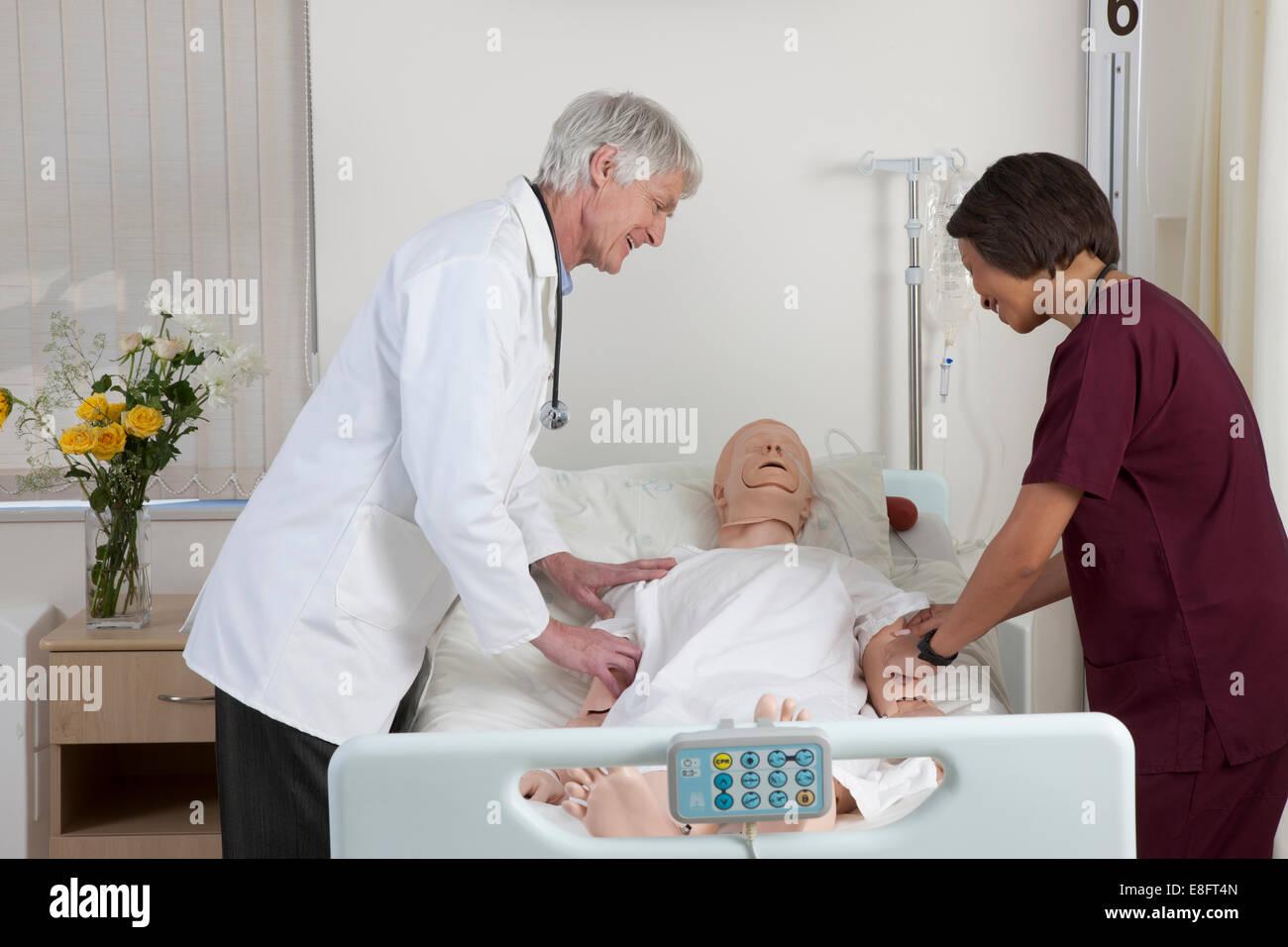 dc6b7468965 Nurse Training Dummy Stock Photos & Nurse Training Dummy Stock ...