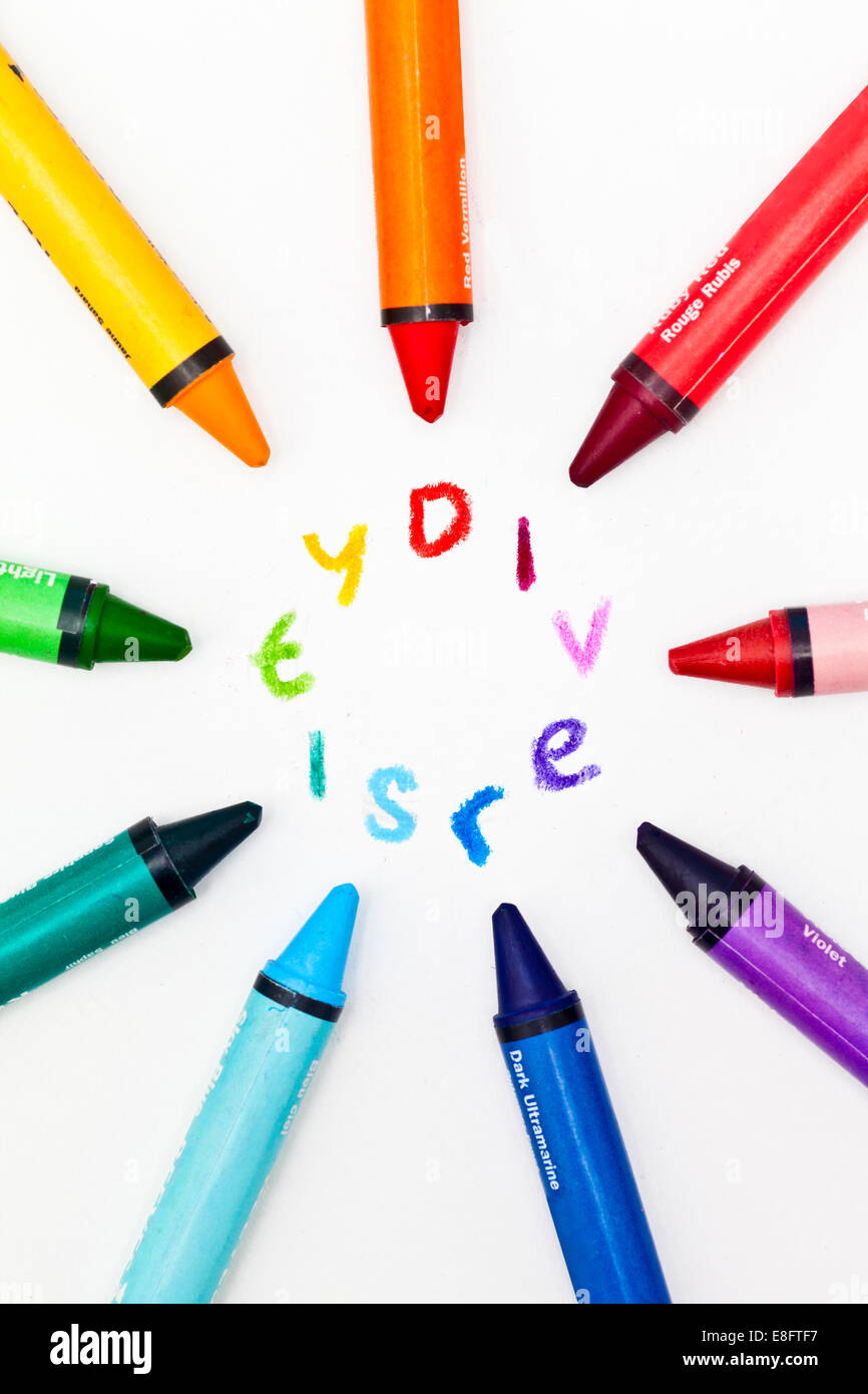Multi-colored Crayons surrounding the word diversity - Stock Image