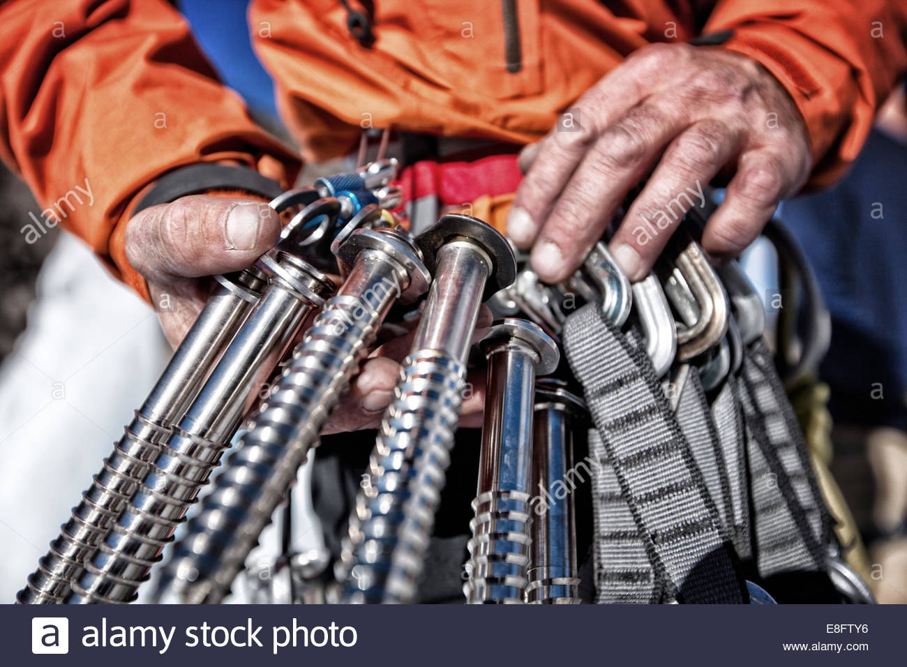 Ice climber holding ice screws, Lake City, Colorado, America, USA - Stock Image