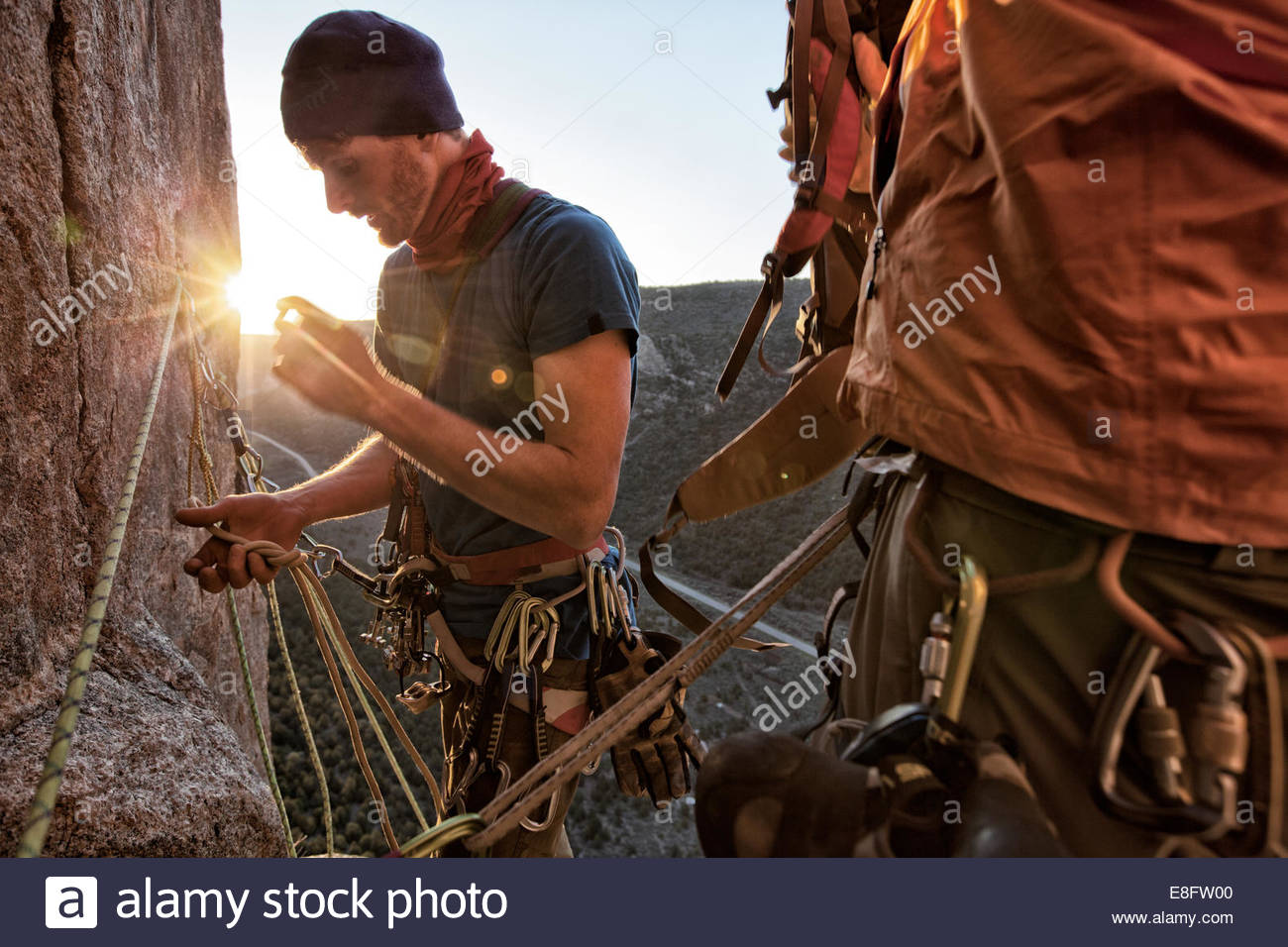 Rock climber inspecting rope, Unaweep Canyon, Colorado, America, USA - Stock Image