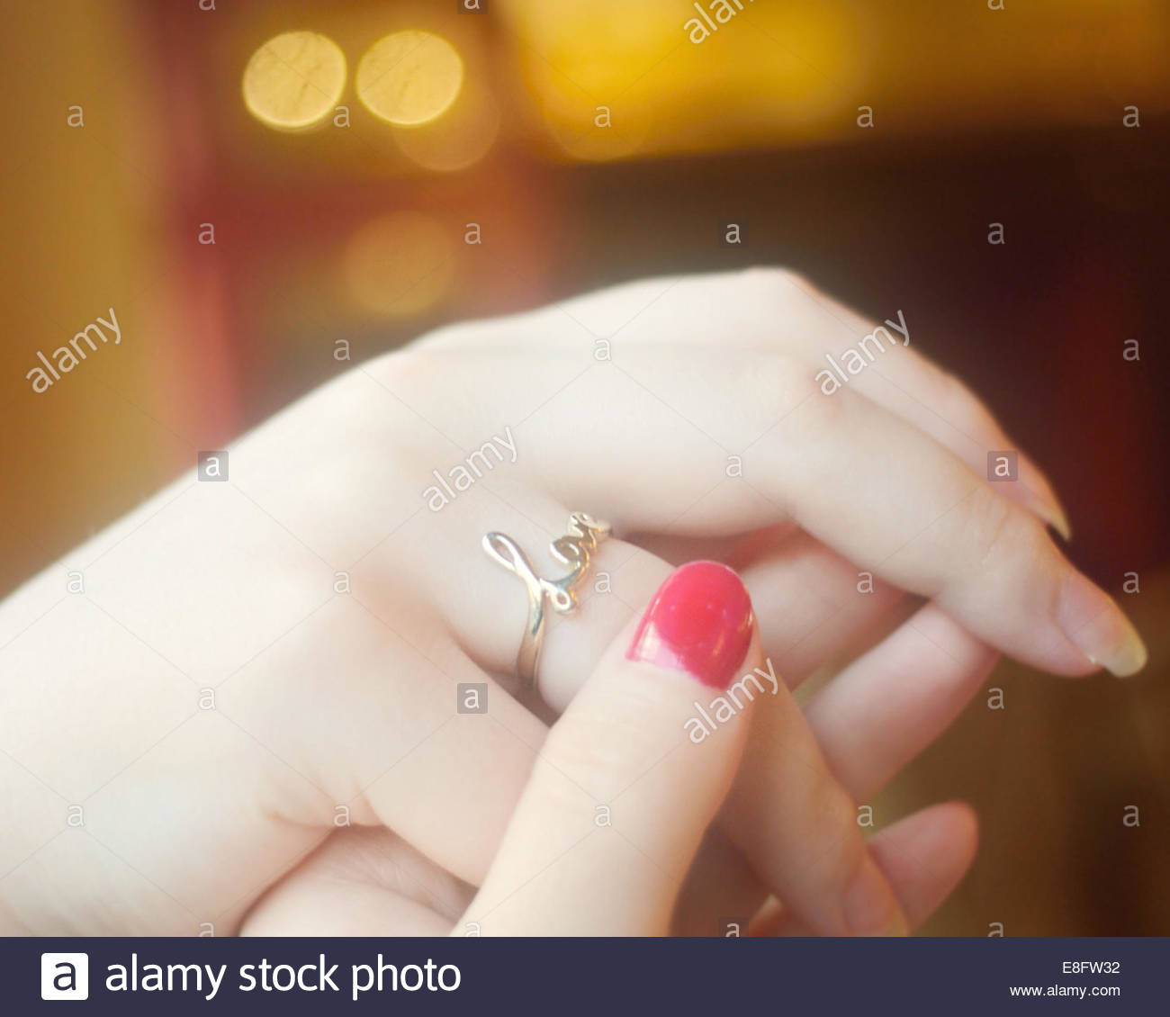 View of hands with love ring - Stock Image