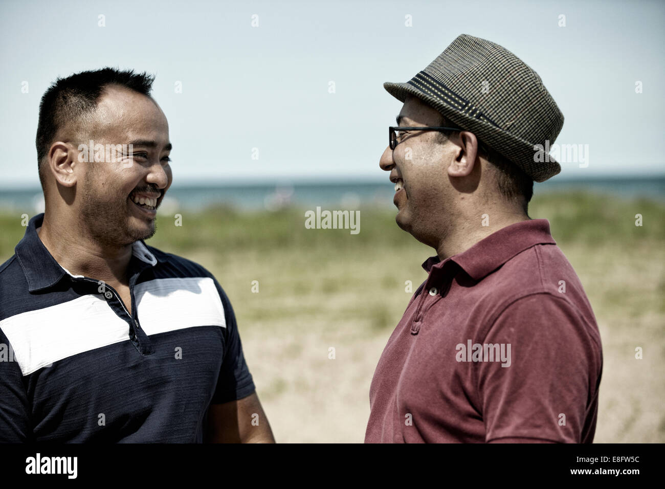 USA, Illinois, Cook County, Chicago, Two men on beach - Stock Image