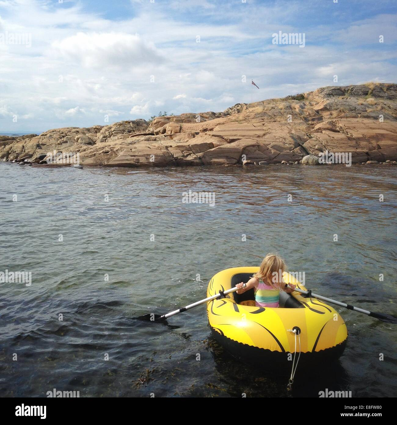 Norway, Girl (12-13) in dinghy - Stock Image