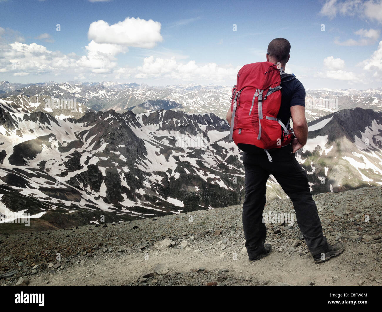 Hiker looking at mountain view, Colorado, America, USA - Stock Image