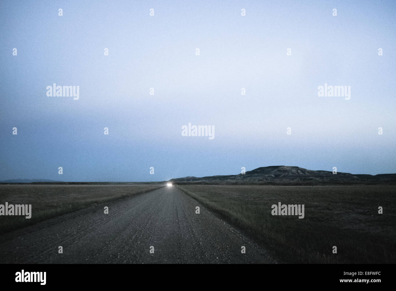 USA, Wyoming,Dirt road at dusk - Stock Image
