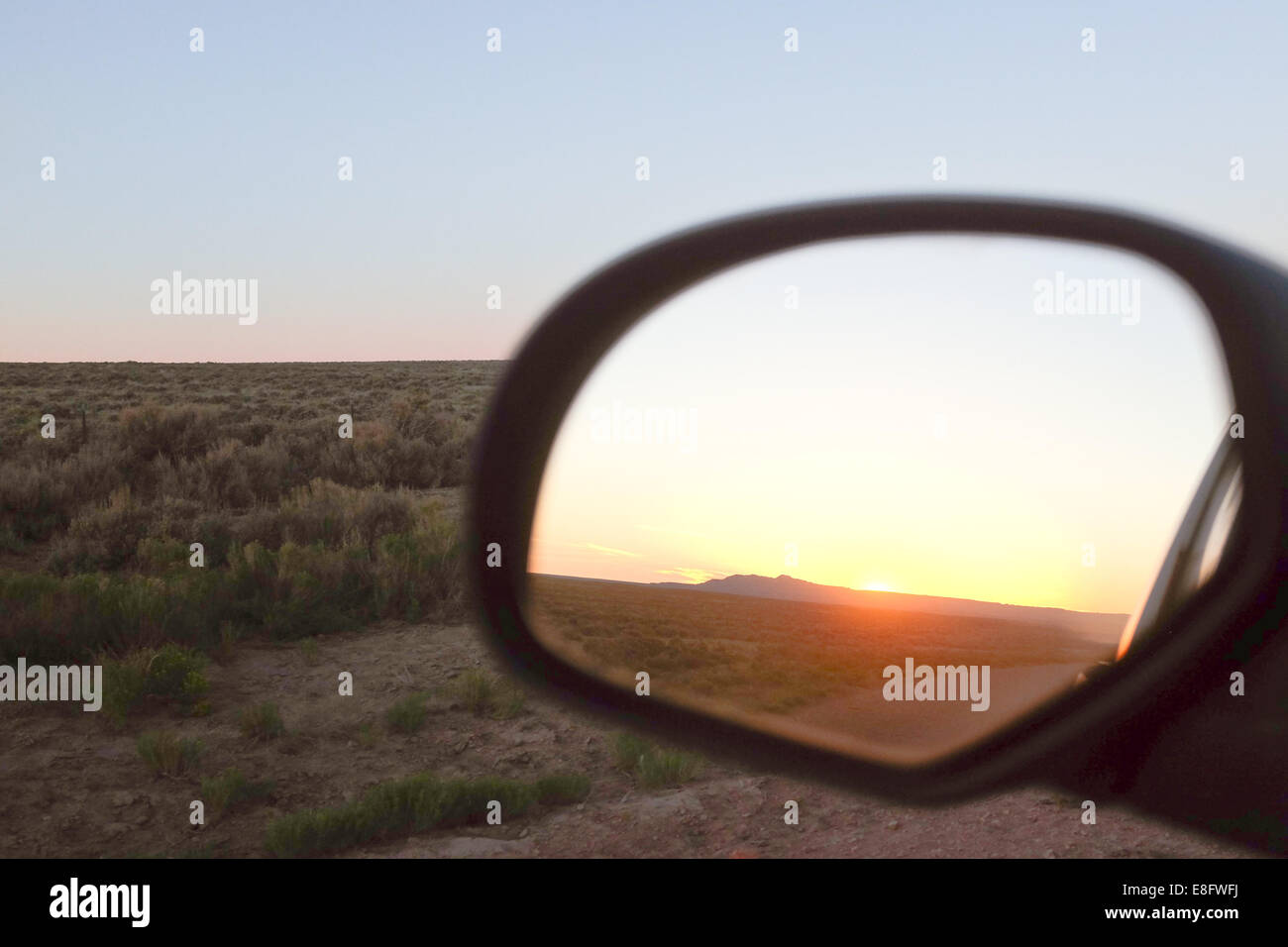 USA, Wyoming, Sunset reflecting in side mirror - Stock Image