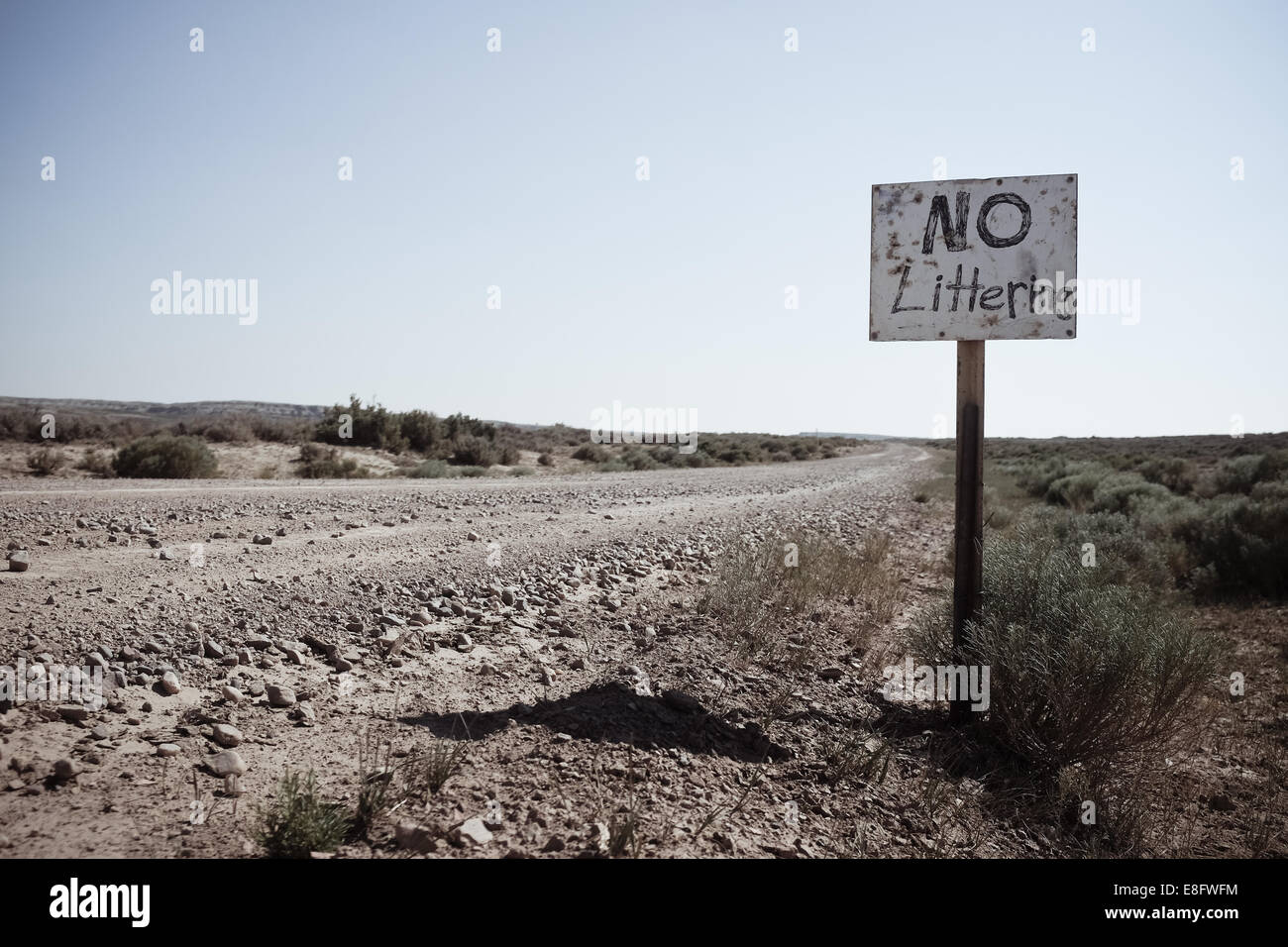 USA, Wyoming, Dirt road and hand made sign - Stock Image