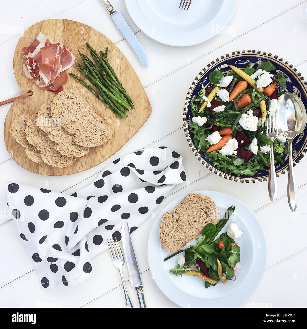Bread, parma ham and salad - Stock Image