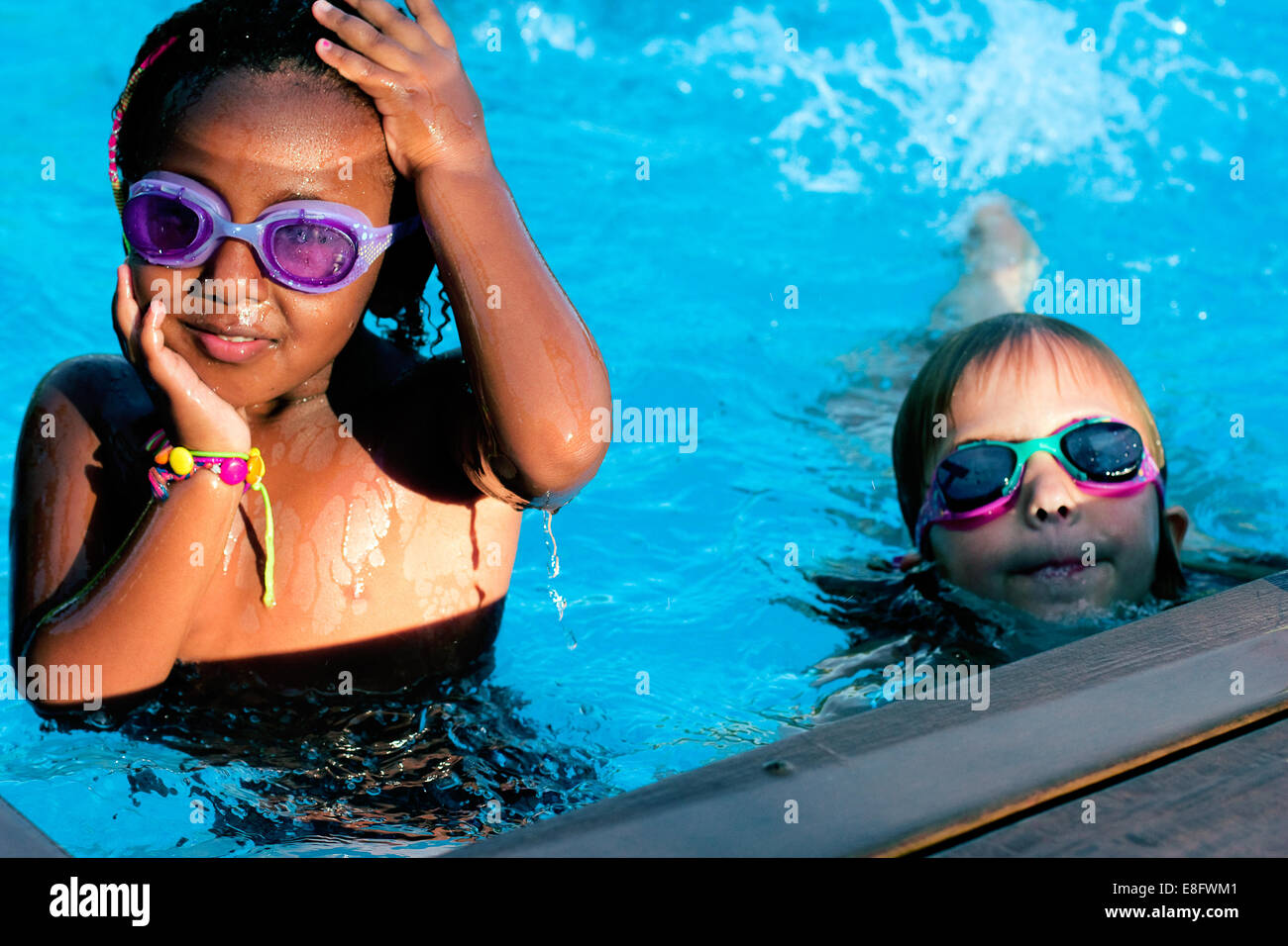 Girl in swimming pool smiling stock photos girl in swimming pool smiling stock images alamy for Female only swimming pool london