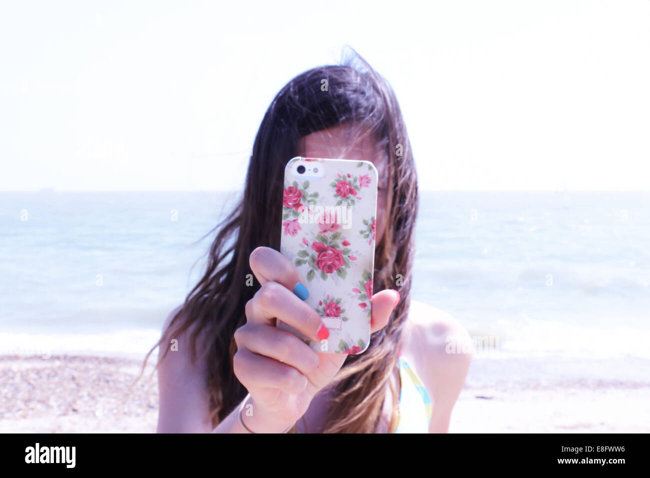 Girl taking photo with her mobile phone - Stock Image
