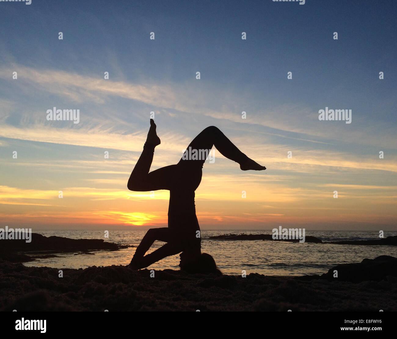 Yoga on beach - Stock Image