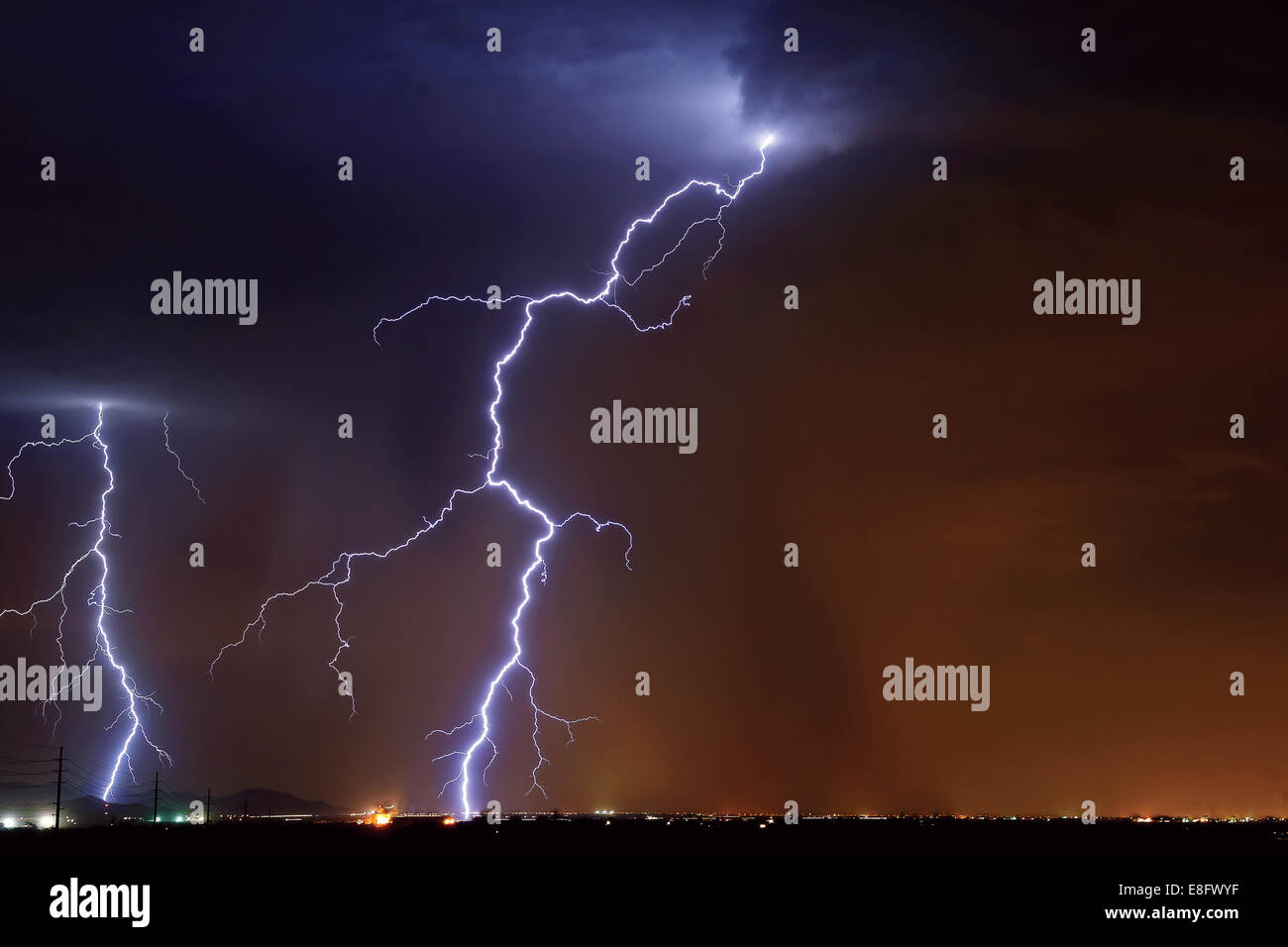 USA, Arizona, Maricopa County, Hassayampa, Lightning striking in farming area near little town - Stock Image