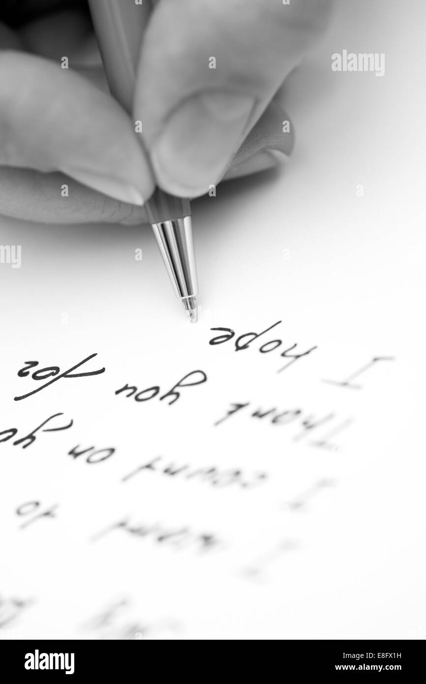 Writing letter to a friend. - Stock Image