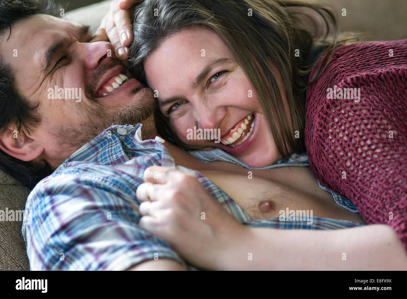 View of cuddling couple - Stock Image