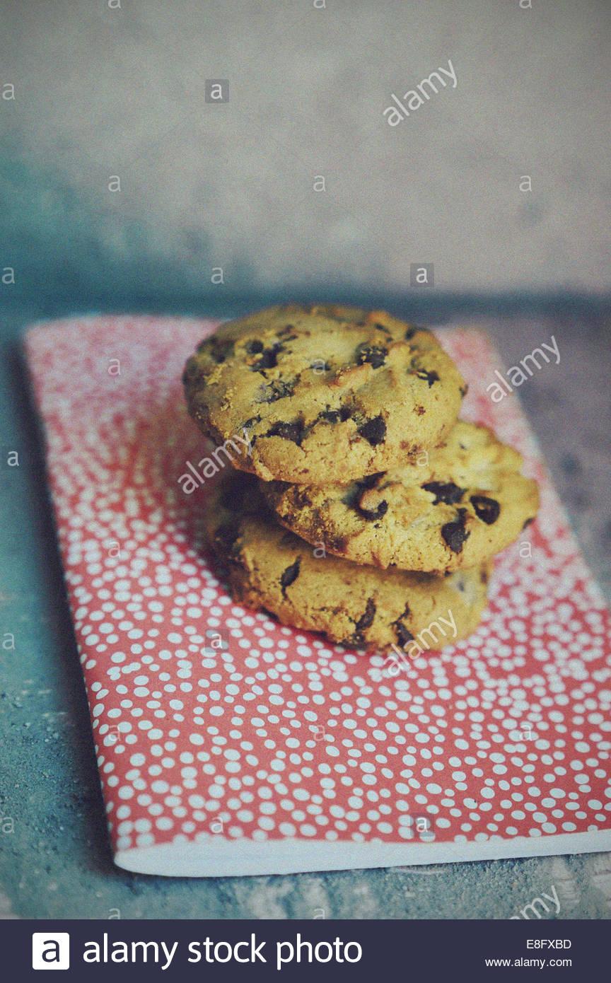 Chocolate chip cookies on polka dot tablecloth - Stock Image