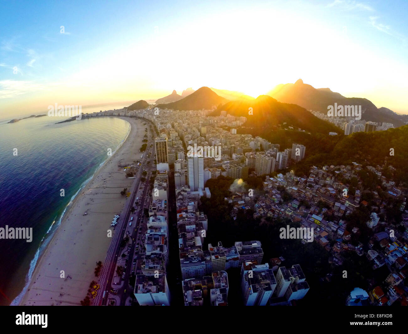 Brazil, Rio de Janeiro, Aerial view of Copacabana Beach at sunset - Stock Image