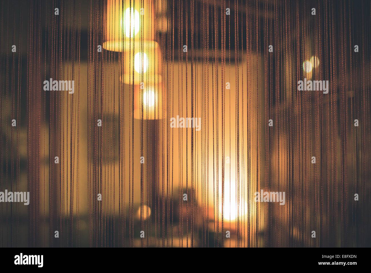 Lights in a bedroom through curtains Stock Photo
