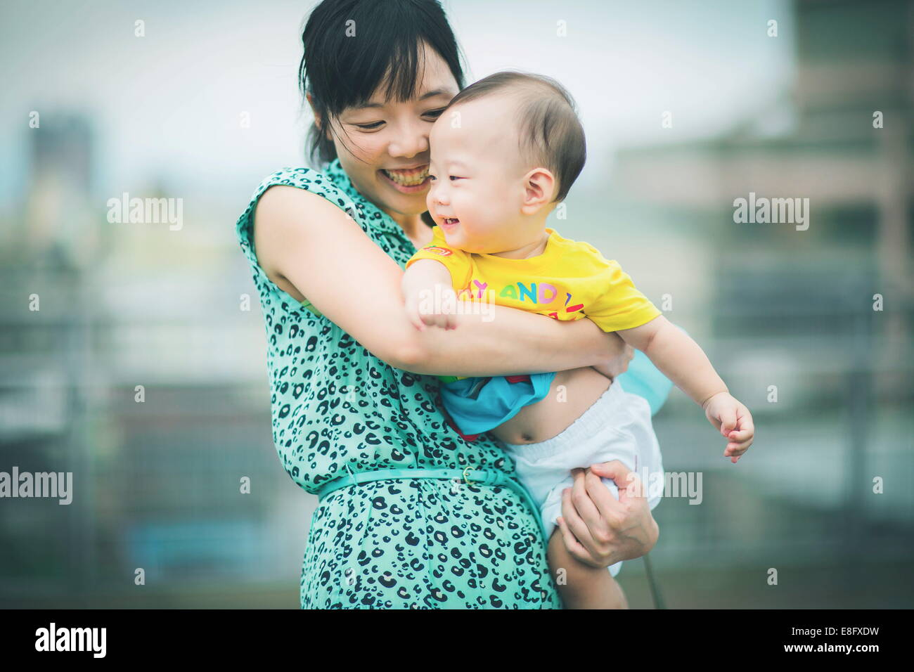 Mother holding son while dancing - Stock Image