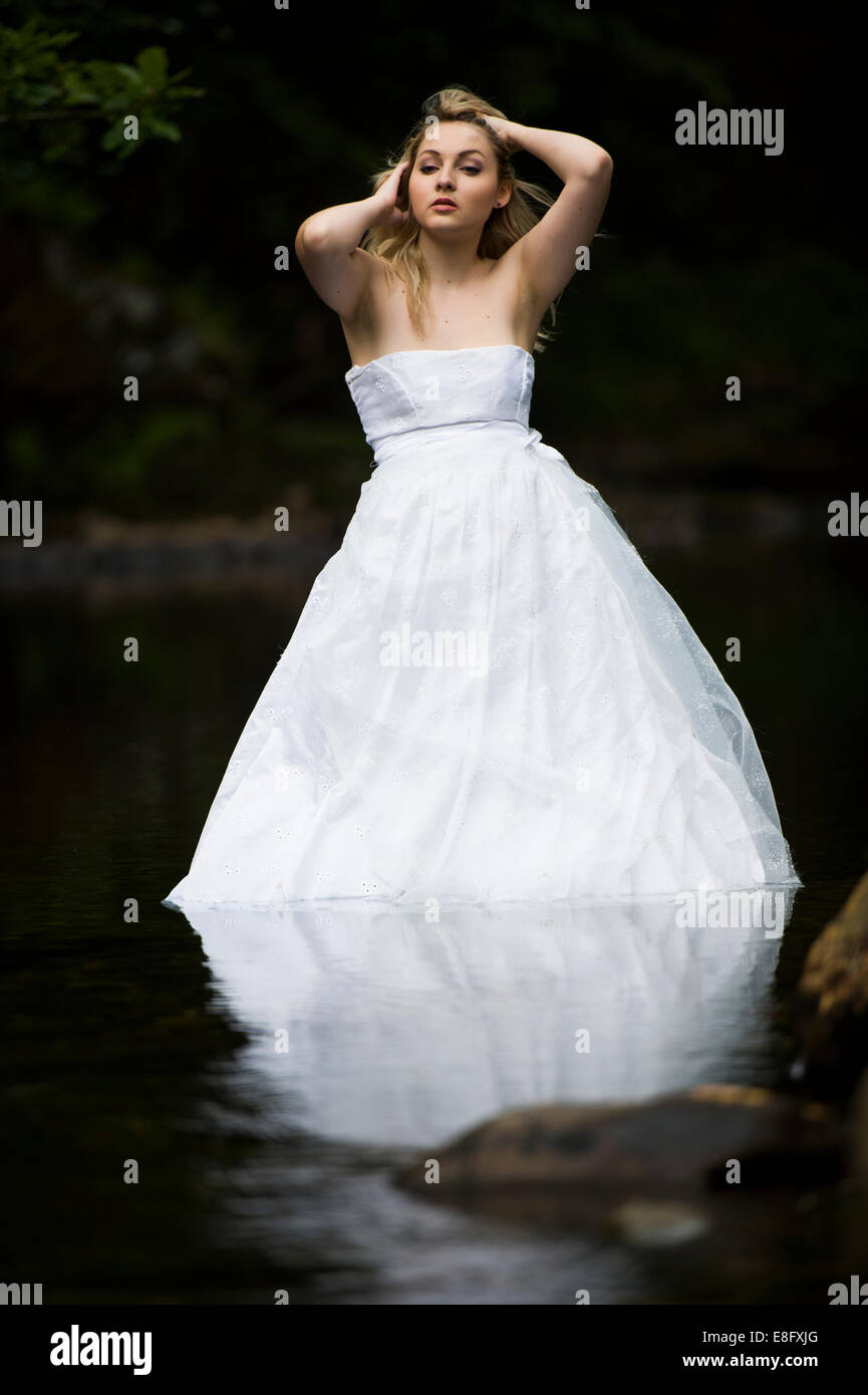 Trash The Dress\': A young blonde woman girl model bride wearing ...