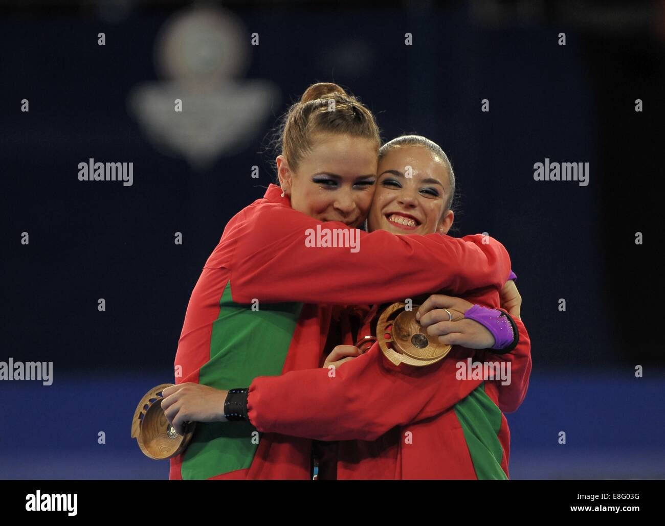 Francesca Jones (WAL, left) and Laura Halford (WAL) cuddle after receiving their silver and bronze medals respectively. - Stock Image