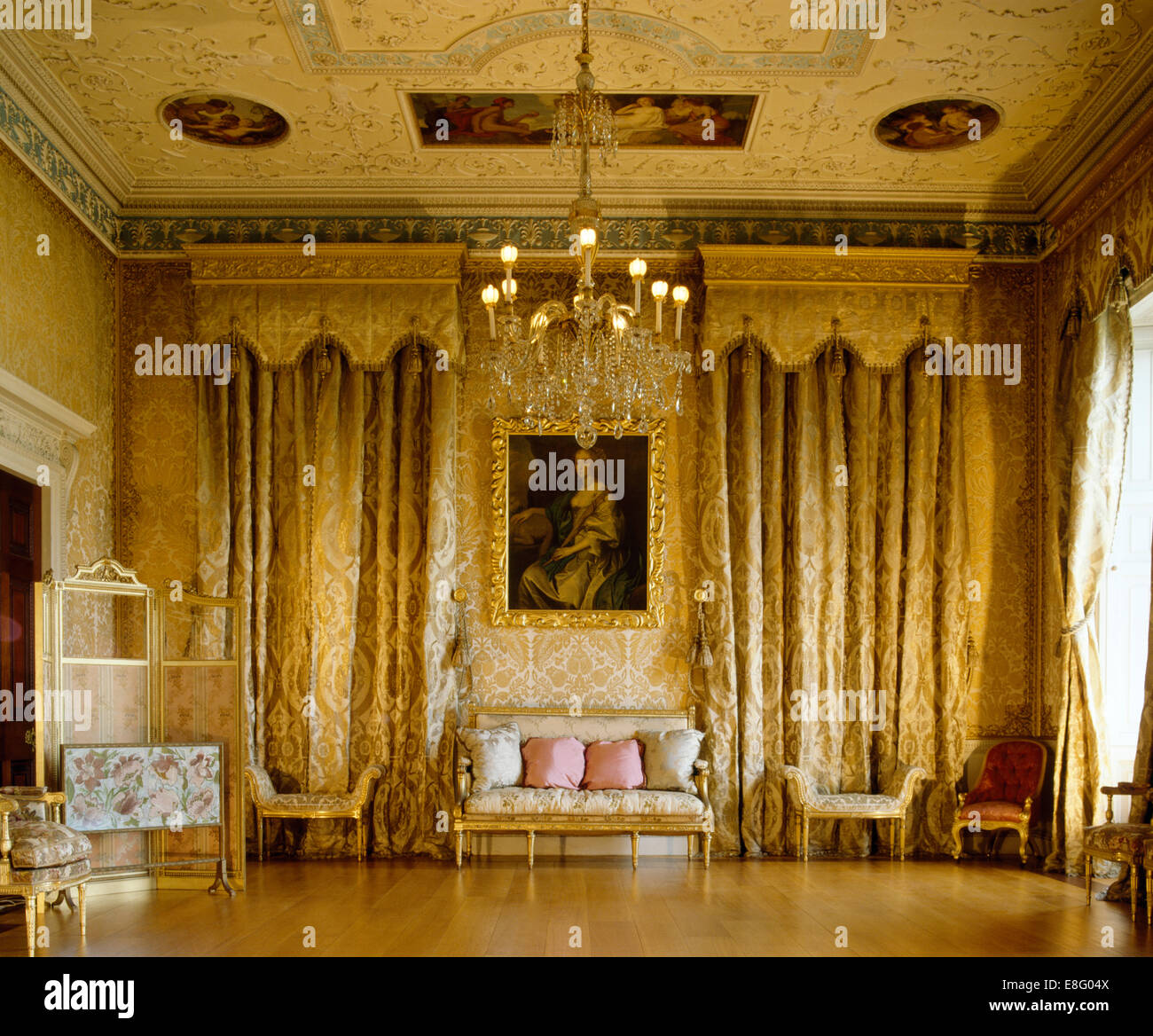 Opulent Gold Curtains And Gilt Furniture In Stately Home Drawing Room
