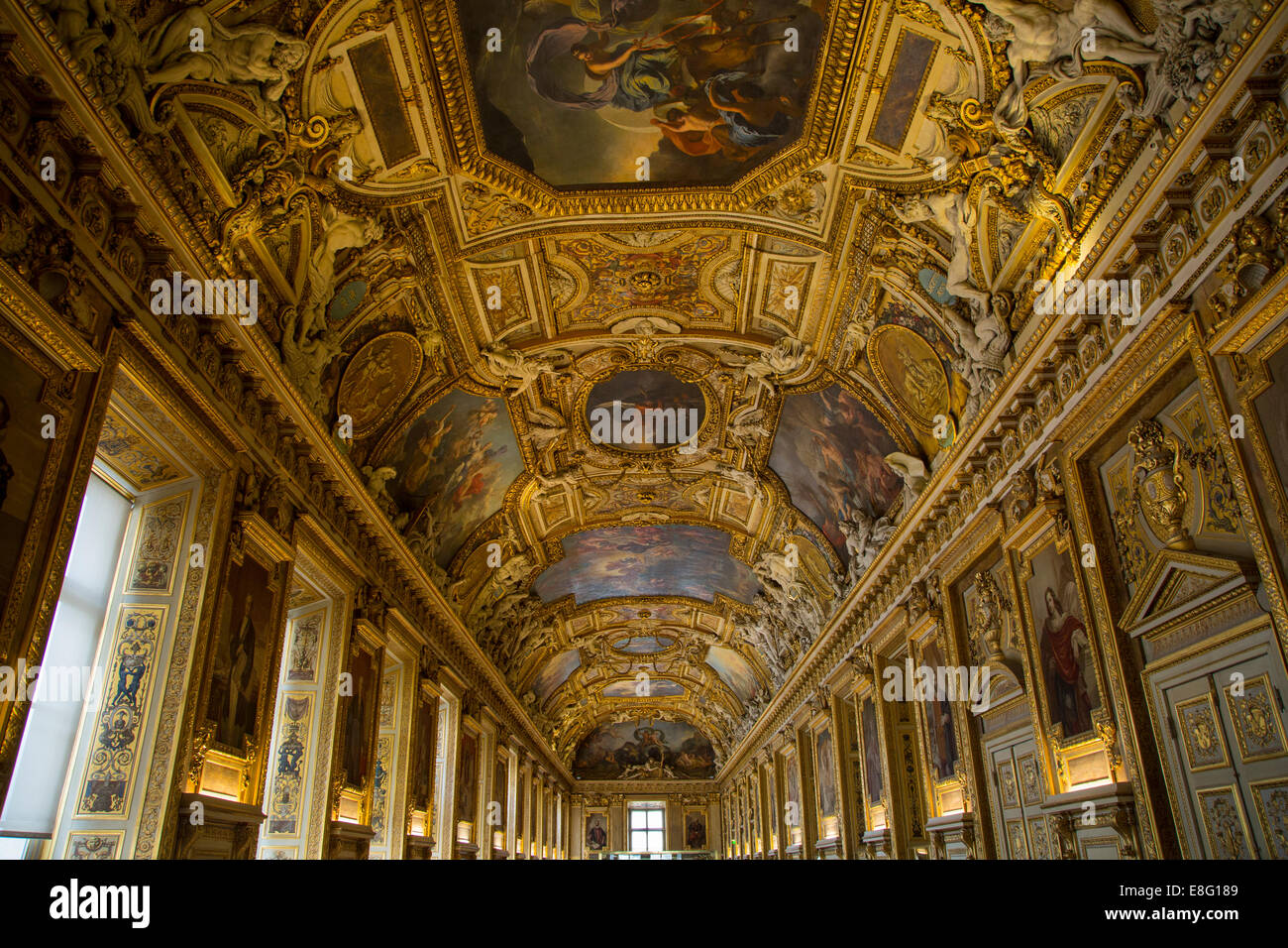 Ornate ceiling in Galerie d'Apollon in the Denon wing of Musee du Louvre, Paris, France - Stock Image