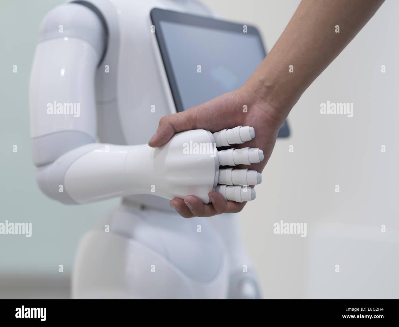 Pepper a humanoid robot by Aldebaran Robotics and SoftBank Mobile. At the Aoyama Softbank Store, Tokyo, Japan. - Stock Image
