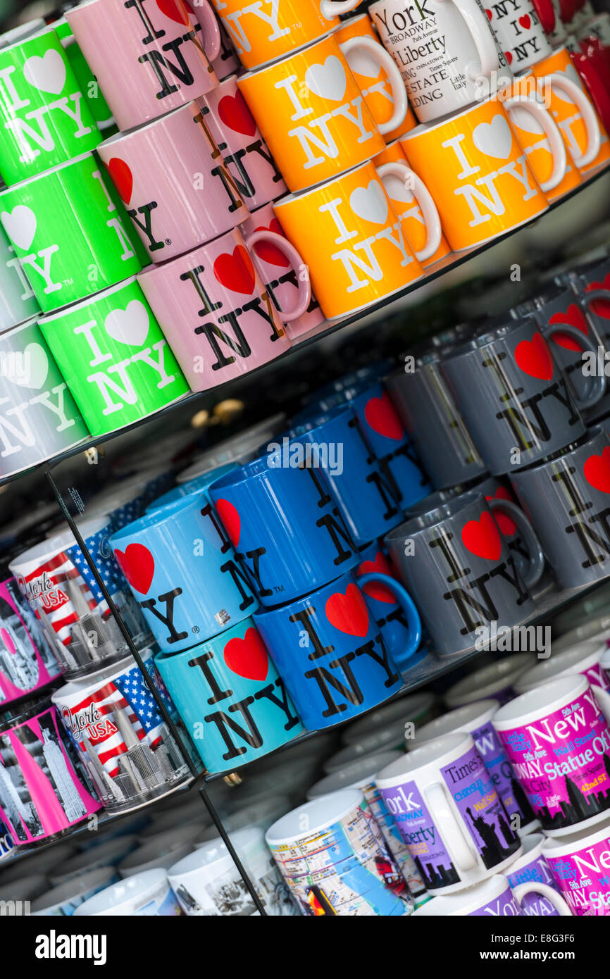 Rows of 'I Love NY' Mugs piled high in a gift shop in New York City. - Stock Image